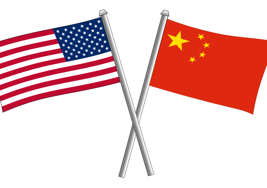 The United States and Chinese flag crossing each other.