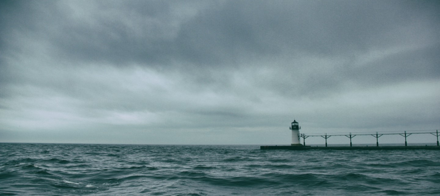 rough seas with lighthouse