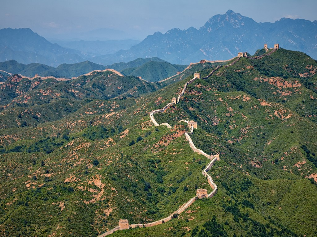 Aerial view of the great wall of China on mountains.