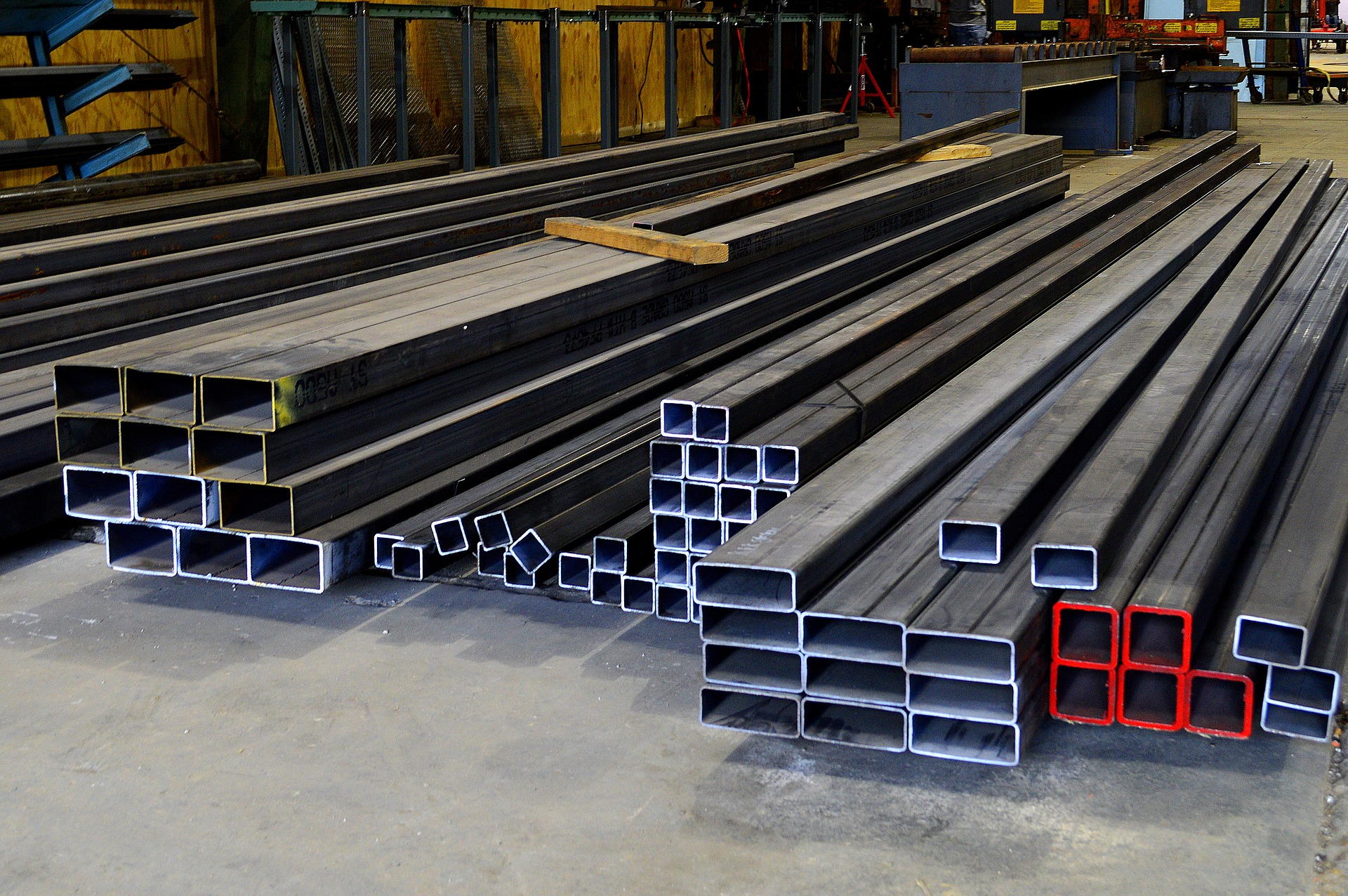 Variety of different stacked steel beams.